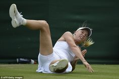 LONDON - The Championships Wimbledon ... DANGEROUS, WET GRASS!! Taking a tumble: Caro Wozniacki falls over in the 4th game of her 2nd round v  Petra Cetkovska. Caro would go on to lose her match.  6/26/13