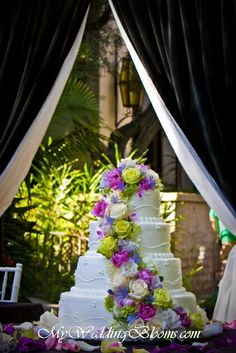 i love this wedding cake! white with purple and green accents
