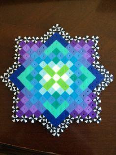 Trippy perler bead kaleidoscope design