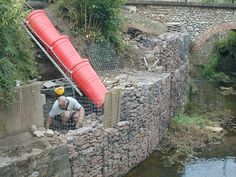 example of our gabion baskets used to solve a river erosion problem. Gabion wall is curved. Gabion Wall Design, Retaining Wall Construction, Gabion Retaining Wall, Gabion Baskets, Construction Images, Landscaping On A Hill, Dry Stone, River Bank, Garden Pictures