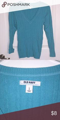 Old Navy cable knit stretch sweater. Large Blue Old Navy cable knit sweater. Cozy warm sweater. Stretchy fabric but goes back to form nicely after washing. Old Navy Sweaters