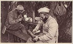 WWI French soldiers making trench art