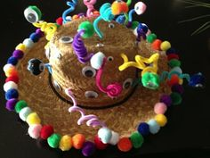 Crazy Hat Day hat: pipe cleaners, pom-poms and googly eyes.  Musings of a Momsomniac: Wearing Many Hats...