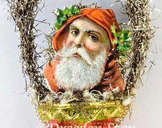 Red Hooded Santa in Red Glass Basket with Green Bell