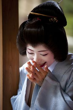 Japanese etiquette: A lady always covers her mouth when smiling or laughing. I was never taught this, but do it instinctively anyway - well, with laughing, that is.