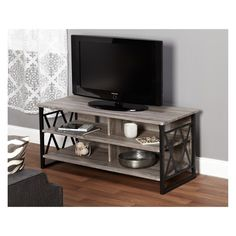 """Add a contemporary look to your living space with this 48"""" Seneca TV stand from Buylateral. This stand features a steel frame along with laminated MDF board, giving it a reclaimed look. Shelves and drawers allow for ample amounts of storage space for moves, books, audio equipment, decor, etc. Dimensions: 48 x 20 x 22 inches."""