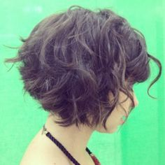 short curly stacked bob with bangs
