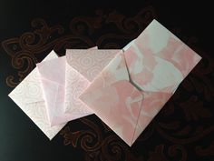 12 Assorted pink mini envelopes