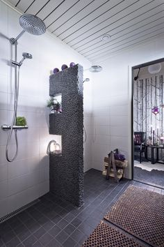 I like the rock wall. Not sure of the purpose here, but would like it between a bathtub and shower.