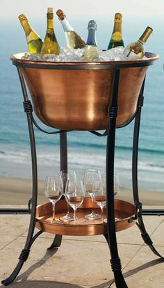 This Copper Beverage Tub holds enough drinks and ice to keep a crowd refreshed for hours and is sure to be an eye-catching focal point at your next party.