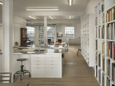 White Loft by Qb3 in Philadelphia, 'smart' storage bookshelves/display cases/room dividers, exposed heating ducts, bleached maple floors, Remodelista