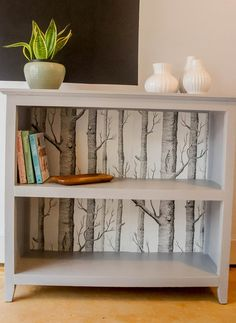 A bookshelf makeover with paint and leftover wallpaper. Make that boring bookshelf amazing!<br> Learn some tips for a bookshelf makeover. Transform that boring bookshelf with leftover wallpaper and paint for un updated, unique look! Wallpaper Bookshelf, Wallpaper Furniture, Paint Wallpaper, Wallpaper Backgrounds, Wallpaper Ideas, Wallpaper Crafts, Bedroom Furniture, Refurbished Furniture, Repurposed Furniture