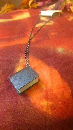 Hey, I found this really awesome Etsy listing at https://www.etsy.com/listing/204525127/book-necklace