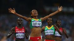 Meseret Defar of Ethiopia celebrates winning gold in the women's 5000m Final on Day 14 of the London 2012 Olympic Games at Olympic Stadium.