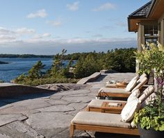 Georgian Bay, Ontario Patio: A flat stone terrace that's large enough for loungers.