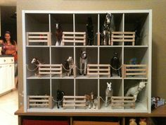 My daughter, Jayden, kept leaving her horses EVERYWHERE.  So I thought of the perfect storage for them.  Shoe organizer turned into toy horse stable.  Just hot glued some popsicle sticks, chains, jump rings, and string.  Boom!  Not only is my living room horse-free now, but she plays with the stable every single night. :)