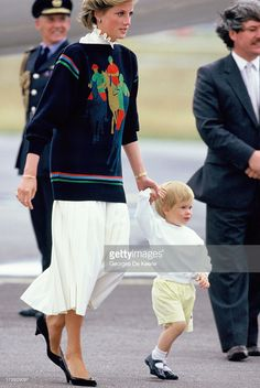 Diana, Princess of Wales, and her young sons Prince William and Prince Harry arrive at Aberdeen Airport for the start of their holidays in Scotland on August 15, 1986 in Aberdeen, Scotland.
