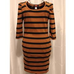 Forever 21 Long Striped Dress Forever 21 striped black and brown dress. Size medium. 3/4 sleeves. Just above the knees in length. Very stretchy material that will hug most sized curves. I wore it only once so in perfect condition. Forever 21 Dresses Long Sleeve