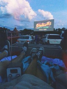 Drive-in theaters in the summer with blankets on the roof or in the back