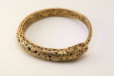 Ornate Gold Vermeil Filigree Ouroboros Serpent Bangle with faceted Garnet Eyes