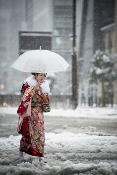 'Young Lady in Red Kimono crossing the streets of Tokyo under the snow' by Damien D'Angelo on 500px