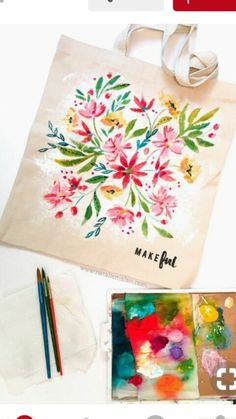 DIY to Paint a floral tote bag in acrylics. WIth Natalie Malan and Be Makeful. – Natalie Malan DIY to Paint a floral tote bag in acrylics. WIth Natalie Malan and Be Makeful. DIY to Paint a floral tote bag in acrylics. WIth Natalie Malan and Be Makeful. Painted Canvas Bags, Canvas Tote Bags, Floral Tote Bags, Diy Tote Bag, Crafts To Make And Sell, Cloth Bags, Fabric Painting, Diy Bag Painting, Handmade Bags