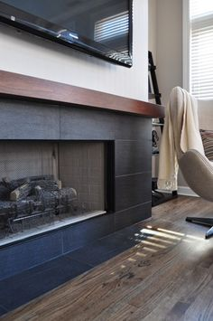 Idea to redo our brick fireplace surround with long narrow black tiles (that I already have!!!)