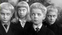 Vollage of the Damned (1960). The children of the village of Midwich, England. Don't make them mad. http://www.imdb.com/title/tt0054443/?ref_=nv_sr_2