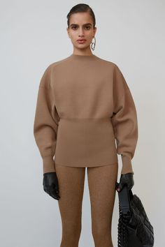 Acne Studios desert beige sweater is shaped with dolman sleeves and a wide, ribbed waist. Acne Studios, Marketing Direct, Filipino Fashion, Pullover, Crewneck Sweater, Fashion Silhouette, Beige Sweater, Knit Fashion, Batwing Sleeve