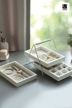 $35 · Terrace Jewelry Tray features three stacked trays, each with dividers optimized for organizing jewelry and keeping it safe. Made of high-quality, Paulownia wood and metal wire frame for stacking its trays, Terrace is a piece you will be proud to leave out in your home. This piece makes excellent use of vertical space, stacking the trays, freeing up space on your vanity or counter, while adding a nice decorative dimension of height and material to any space in your home. Jewelry Tray, Jewellery Storage, Organizing Jewelry, Wire Frame, Wall Organization, Small Space Living, Minimalist Bedroom, Dividers, Dorm Decorations