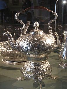 """Silver teapot by Samuel Courtauld, London, 1748-49 in the strong London silversmithing trade: Paul de Lamerie, Paul Crespin, Nicholas Sprimont, the Courtauld family, as well as Englishman Georges Wickes. Nikolaus Pevsner """"the most influential of all English innovations in art"""". The French-born engraver Hubert-François Gravelot, in London from 1732 to 1745, was a key figure in importing Rococo taste in book illustrations and ornament prints for craftsmen to follow"""
