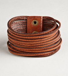 Leather bracelet..would especially dig it in black...or a steely grey...or dark olive green...