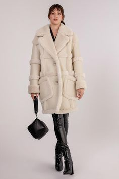 A two looks in one, reversible shearling leather coat with sophisticated wool stripe details. Notched lapel with soft wool. Shearling interior and soft wool cuffs. Double button closure with lining design. Shearling Vest, Line Design, Cuffs, Fur Coat, That Look, Fall Winter, Winter Jackets, Stripes, Closure