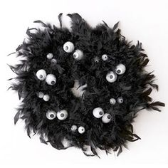 Cute halloween wreath made from black boa and foam balls.  Click for directions.