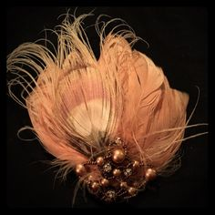 Shop Women's size OS Hair Accessories at a discounted price at Poshmark. Description: Beautiful steampunk inspired peacock feather hair clip. Worn once to a wedding. Subtle peachy color with beautiful bead work. One of a kind!. Sold by velma6579. Fast delivery, full service customer support.