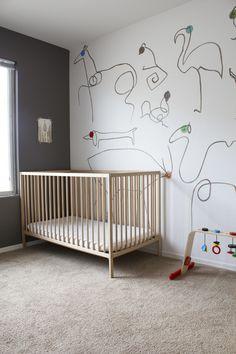 Minimalist style nursery. Amazing hand-painted wall! So cool!