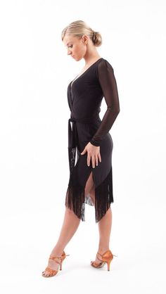 """Classic wrap dress with separate waist tie, and mesh long sleeves. Diagonal hem with side slits for comfortable movement. 8"""" fringe hem moves fantastically on the dance floor! PERFECT FOR: Samba, Argentine Tango, cha cha, rumba, Paso Doble, and Bolero.:"""