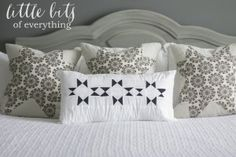 Little Bits of Everything Blog. Master Bedroom Reveal, Gray and White bedroom, quilted pillows, white bedding, Goodwill lamps, furniture makeover, gray furniture. Before and after. vintage plates