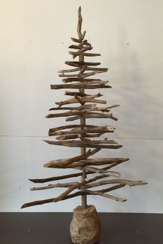 Stick Christmas Tree by PalletandWood on Etsy https://www.etsy.com/au/listing/252900853/stick-christmas-tree