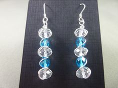 Faceted blue and clear glass beads wrapped with a non-tarnish silver wire and finished with sterling silver earwires. Tarnished Silver, Sterling Silver, Wire Wrapped Earrings, Drop Earrings, Clear Glass, Glass Beads, Wire Wrapping, Blue, Jewelry