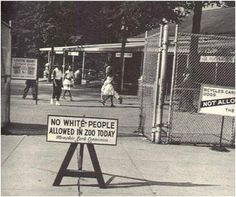 """1959 - Sign placed in front of the Memphis zoo on Thursday """"Negro day,"""" the only day of the week that African Americans were allowed to visit the facility."""