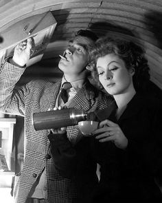 Walter Pidgeon & Greer Garson as Mr. and Mrs. Miniver