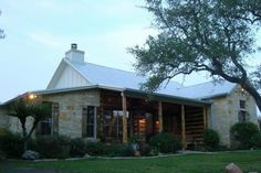 Small texas hill country home design porch beams for Hill country classic homes