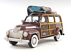 """CaptJimsCargo - 1947 Chevrolet Suburban Woody Metal Car Model 14"""" Automobile Automotive Decor, (http://www.captjimscargo.com/model-tether-cars-automobiles/1947-chevrolet-suburban-woody-metal-car-model-14-automobile-automotive-decor/) This 1947 Chevrolet Suburban Woody automotive model is completely hand-built & handcrafted of metal with a metal frame."""
