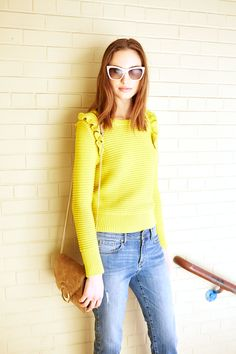 Looking for a winter wardrobe pick me up? Look no further than our bold yellow ruffle pullover sweater. Style it with a pair of light wash jeans for a casual yet chic look | Banana Republic