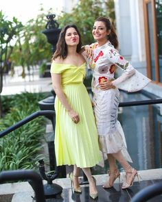 They are made of sugar and spice and everything nice. Stunning Kajal Aggarwal and Tamannaah Bhatia at a private Event. Kajal Agarwal on white color dress with floral print and net bell sleeves. Tamannaah in lie yellow color off shoulder dress. Stylish Dresses, Trendy Outfits, Casual Dresses, Fashion Outfits, Western Dresses, Western Outfits, In Her Eyes, Most Beautiful Indian Actress, Dress Makeup