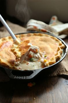 30 Minute Skillet Chicken Pot Pie - Topped with flaky crust just like grandma made, but in record time! - www.countrycleaver.com