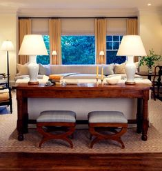 I love the idea of added seats/ottomans under a table behind the couch
