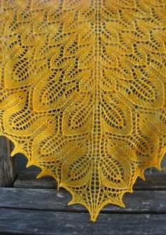 sunflower shawl  summer inspired shawl by Emily Wessel-- super easy, great charts (all on one page) & it looks great.  I am on my third one this month.  Looks lovely in Knitpicks Palette, 3 balls for a small 5 for a large.  I also used a 5mm and a 4.5mm needle instead of the 4mm called for.  They all work.  The larger the needle the airier it is.