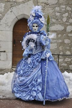 Frothy dress of true blue and embellished with swans at Carnival of Venice.